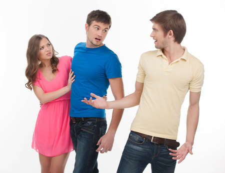 conflicting: Men conflicting  Two angry men conflicting about girl while standing isolated on white