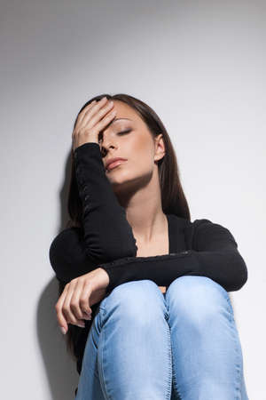depressed woman: Depressed women. Young depressed women sitting with her hand on face