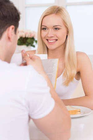 Having breakfast together. Young loving couple having breakfast together photo