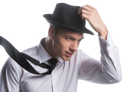 strong wind: Portrait of fashionable man holding his hat. Facing a strong wind, isolated on white Stock Photo