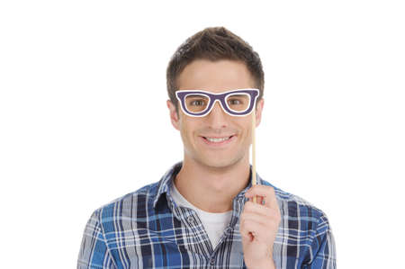 Man in party glasses. Handsome young man in party glasses looking at camera and smiling while isolated on white photo