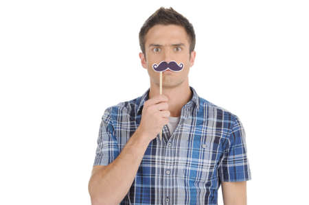 Man with fake moustache. Handsome young man with fake moustache looking at camera while isolated on white photo