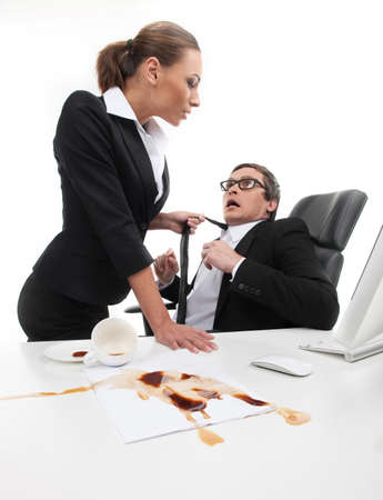 What are you doing? Stressed young businessman looking at his secretary holding his necktie Stock Photo - 23423576