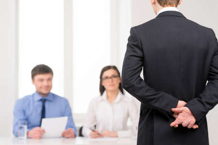 unethical: Close up of man back with fingers crossed behind. Idea of lying on job interview
