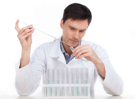 biochemist: Scientific experiment. Confident young man making scientific experiment while sitting isolated on white Stock Photo