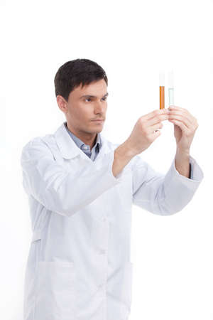 biochemist: Biochemist. Confident young man holding laboratory glass while isolated on white Stock Photo