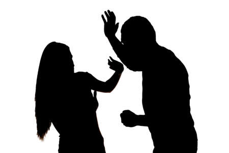offence: Silhouette of  scared woman protecting from male attack. Idea of  criminal offence