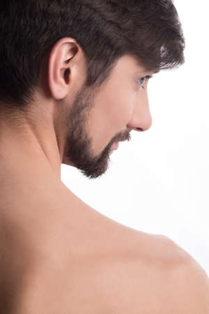 Guy looking away. Side profile of a handsome man looking away photo