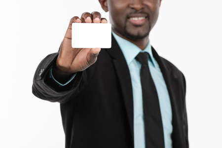 Portrait of African Businessman with blank business card photo