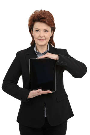 Businesswoman holding digital tablet, front view photo
