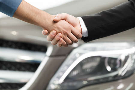 good deal: Good deal. Close-up shoot of the hands shaking in front of the car