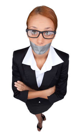 liked: She liked telling gossips. Beautiful young businesswomen standing with her arms crossed and her mouth covered with an adhesive tape while isolated on white
