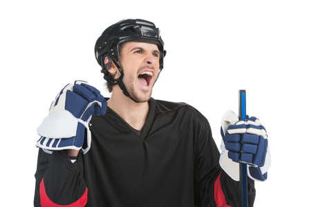 Close up of screaming hockey player. Isolate on white photo
