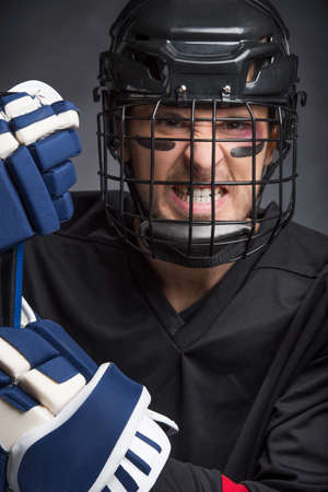 Close up of Angry face of hockey player. Isolated on black background photo