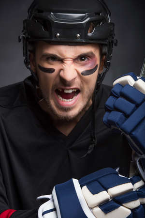 Portrait of hockey player with screaming angry look. Without One tooth photo