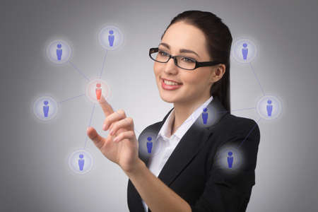 businesswoman managing her contact network, pressing hi-tech buttons photo