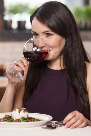 Women drinking wine. Beautiful mature women drinking wine in restaurant photo