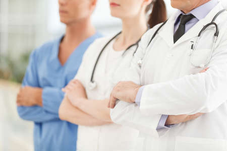 Only professional medical assistance. Cropped image of successful doctors team standing together with their arms crossed