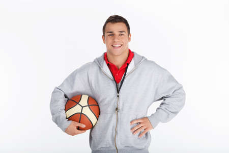 Basketball trainer. Smiling coach with basketball photo