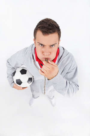 distorted image: Soccer coach. Soccer coach blowing a whistle Stock Photo