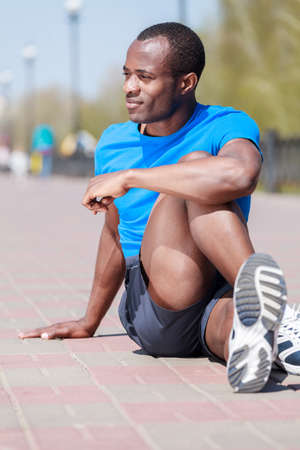 Outdoors exercising. Young african decsent men doing his outdoors exercises Stock Photo - 23926807