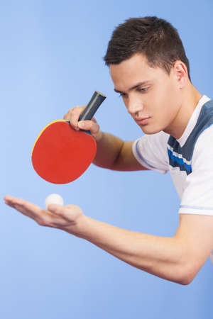 table tennis: Serving a ball. Confident young men playing table tennis