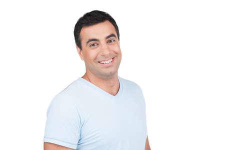 Confident smiling Indian man in blue T-shirt. Standing isolated on white background photo