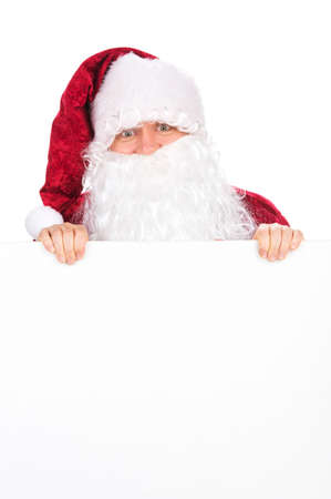 Santa Claus with big white beard looking over blank poster. Portrait isolated over white background photo