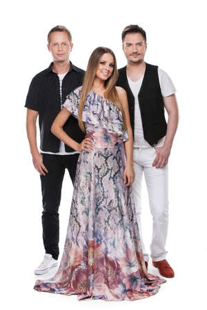 Beautiful lady and two men posing on camera. Standing together full length isolated over white background photo