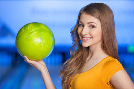 tilt: Woman in bowling alley. A woman having fun while bowling.