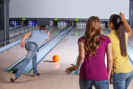 bowling alley: Bowling. Bowling. Friends having fun while bowling. Stock Photo
