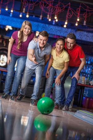 southern european descent: Group of friends bowling. Happy group of friends having fun bowling