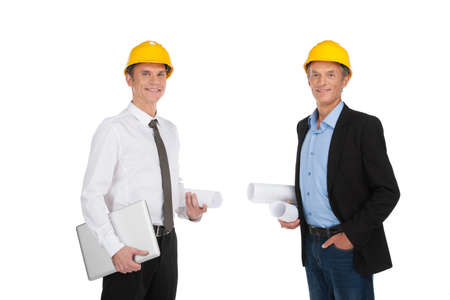 two adult people holding papers. businessmen standing together happy and smiling