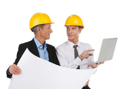 two professional designers drawing plan. foreman and engineer looking at plan and smiling photo