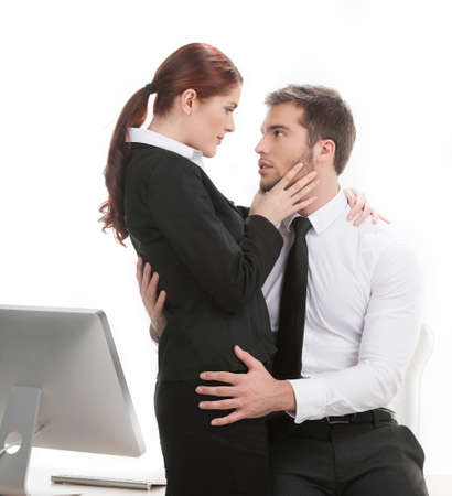 young beautiful coworkers having affair. handsome man touching his colleague at work