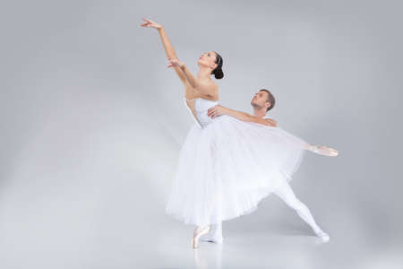 beautiful couple: two young ballet dancers practicing. attractive dancing performers acting on stage Stock Photo