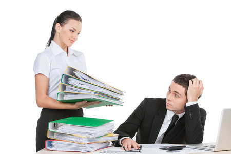 afflict: beautiful young lady holding documents. stressed businessman looking at documents with fear Stock Photo