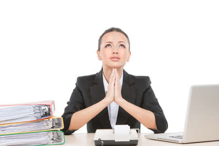beautiful young worker praying and working. attractive business woman sitting at desk photo