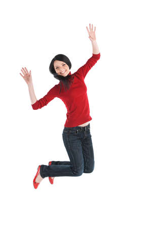 energetically: Cute young girl wearing jeans. Beautiful woman in red top jumping energetically