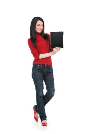 Portrait of smiling young female with tablet. Beautiful girl with long dark hair holding tablet photo