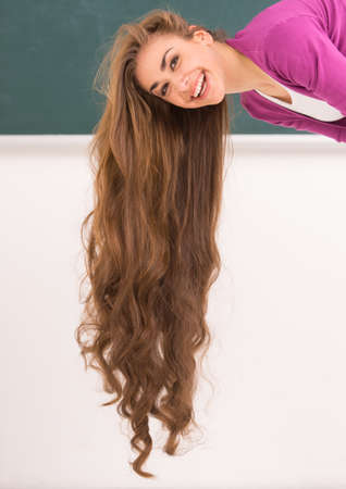 hanging woman: Photo of young woman with long hair. hanging hair of beautiful smiling brunette