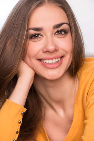 beautiful girl portrait resting on sofa. young woman closeup image with smile photo