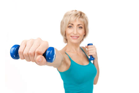 exercitation: aged woman workout using dumbbells. blond lady closeup view waist up