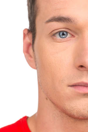 man face close up: portrait of attractive young man half-face. blue eye guy closeup on white background Stock Photo