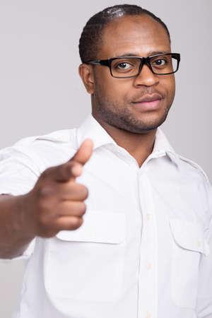 black handsome man pointing finger. man pretends having gun in his hand photo