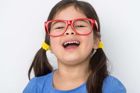 nice little girl wearing glasses. small girl smiling and laughing out loud photo