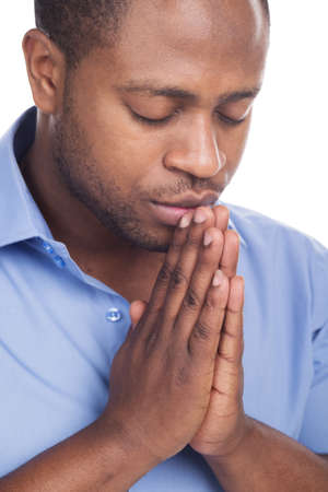handsome black man closed eyes. Man praying in solitude and patience