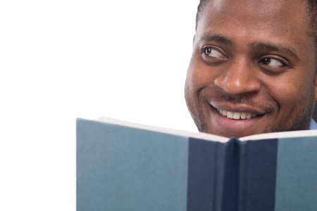 handsome black man looking away. Attractive and smiling male reading book photo