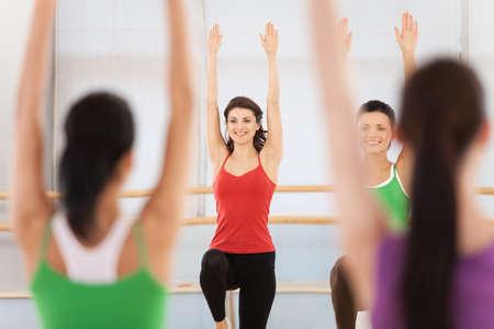 dance teacher: Fitness dance class doing aerobics. Women dancing happy energetic in gym fitness class.