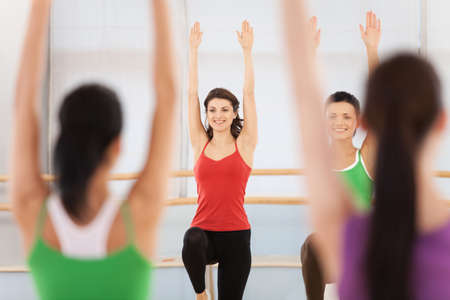 Fitness dance class doing aerobics. Women dancing happy energetic in gym fitness class.